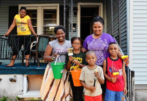 (Lef to right) Sharice Bethea, 11, Kyiana Bethea, 13, Karimah McKnight, 9, Nyasya Bethea, 12 Saviour Marshall, 5, and Messiah Marshall, 7, all of Allentown, look to beat the heat and summer blues by painting the sidewalks with water.