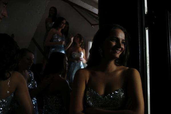 "Miss Greater Rockville Katlyn Lewicke of Milford and the other contestants wait backstage in their opening number outfits before the 2012 Miss Connecticut Scholarship Competition at the Garde Arts Center in New London. The theme of the pageant is ""Lights, Camera, Crown!"" and features 24 contestants vying for the title of Miss Connecticut 2012 and the opportunity to represent Connecticut at the Miss America competition."