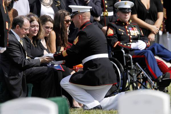 At Marine Sgt. William Stacey's burial at Arlington National Cemetery, Gunnery Sgt. Christopher Albright, center, speaks with Stacey's loved ones. From left, parents Robert and Robin Stacey, sister Anna Stacey and girlfriend Kimmy Kirkwood.