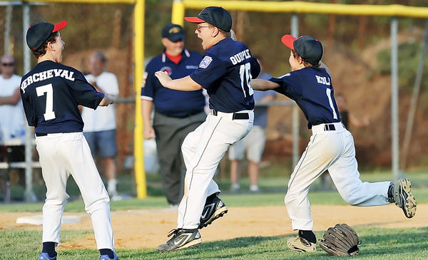 Federal players Garrett Kercheval (7), Brayden Quirple (10) and Braden Kolb (1) celebrate their Maryland District 1 9-10 Little League Tournament championship moments after wrapping up Saturday's victory over West End.