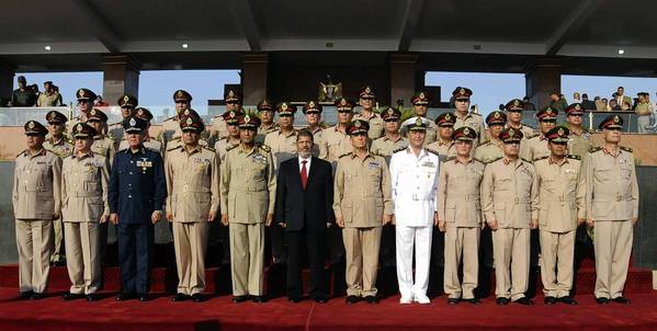 President Mohamed Morsi, center, with Egypt's ruling generals after his inaguration ceremony in Cairo.