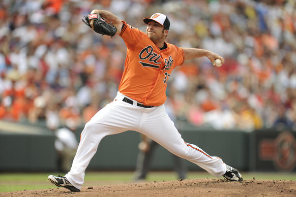 Orioles left-hander Dana Eveland pitches against the Cleveland Indians at Camden Yards.