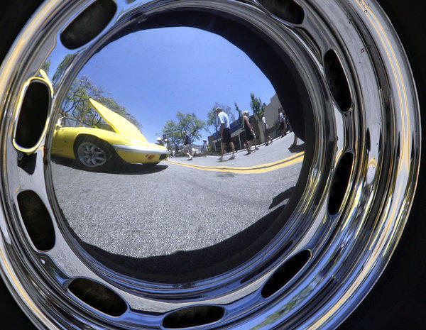 A classic Lotus is reflected on the hubcap of a 1962 Porsche at the Montrose Invitational Car Show in Montrose on Saturday.