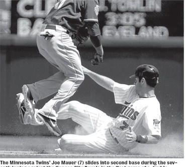 The Minnesota Twins¿ Joe Mauer (7) slides into second base during the seventh inning against the Kansas City Royals in the first game of a doubleheader at Target Field in Minneapolis on Saturday. The Twins topped the Royals 5-1 int he second game after winning the opener 7-2. MCT Photo