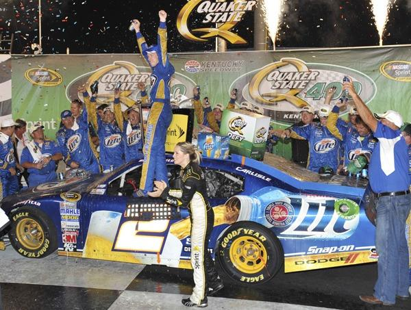 Brad Keselowski celebrates with his crew after winning the 2nd Annual Quaker State 400 at Kentucky Speedway. Keselowski, driving the Miller Lite Dodge captured his 3rd victory this year and 7th of his career in the NASCAR Sprint Cup Series.