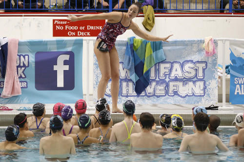 Christine Magnuson giving a clinic for young swimmers at the University of Illinois-Chicago this spring. (Andrew A. Nelles / Chicago Tribune)