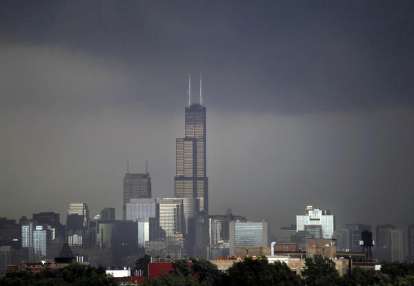 Ominous storm clouds hover over Chicago's skyline on Sunday afternoon.