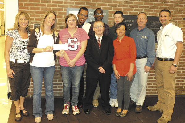Transition Skills program members include, from left, Tammy Thomas, teacher's aide; Cindy Logsdon, teacher; Katie Watson; Marcus Allen; William McCrary; Eric Kauffman; Tyler Johnston; Raynelle Watson; Carl Vogel, Home Builders Association of Washington County representative; and Cory Linthicum, Home Builders representative. Students not in photo are Emily Chaney, Quentin Grimm, Amy Reamy, Heidi Thompson, Tiara Thornton and Jessica Young.