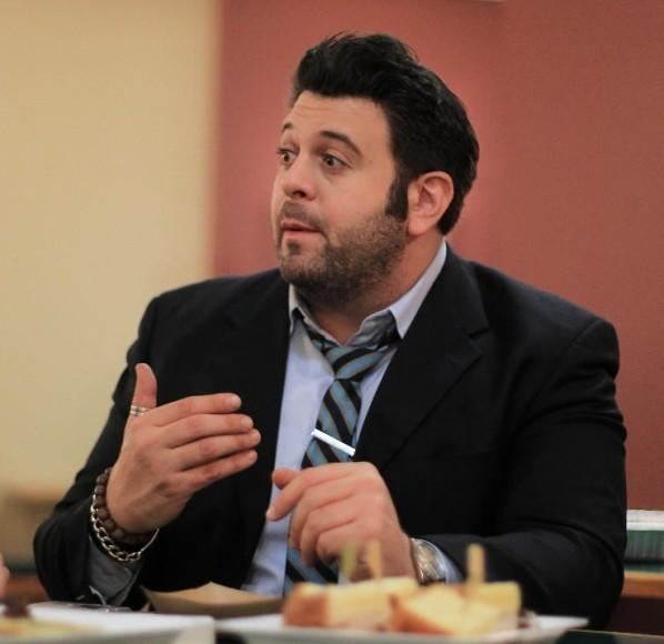 "Former ""Man vs. Food"" host Adam Richman sits in the Tribune Tower cafeteria June 28, 2012."