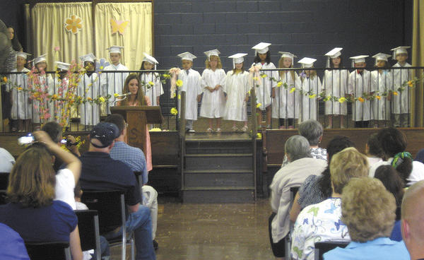 The children at St. John's Parish Preschool in Hagerstown recently participated in a graduation ceremony. Each child wore a cap and gown, and received a personalized diploma. The preschool is affiliated with St. John's Episcopal Church, 101 S. Prospect St. in Hagerstown.