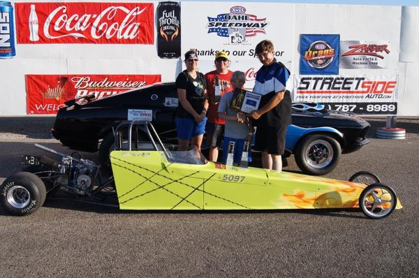 On June 9, Hunter Monson of Groton won three races at Oahe Speedway near Pierre ¿ including the state drag racing championship in the junior dragster division. From left: Wendy Monson and Stan Monson, Hunter's parents; Hunter Monson; and Mike Schmidt of Oahe Speedway.