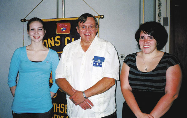 The Smithsburg Lions Club presented scholarships to two students May 23. From left, Megan Ann Hovermale, club President Jeff Weaver and Kaylyn Elizabeth Fox.