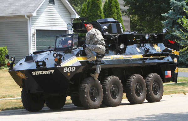 Members of the McHenry County SWAT Team with a tactical response vehicle after a standoff on Glacier Parkway in Algonquin midday today.