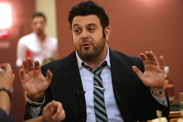 "Former ""Man vs. Food"" host Adam Richman interviewed in the Tribune cafeteri"