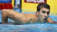 Michael Phelps beats Ryan Lochte in 100-meter butterfly