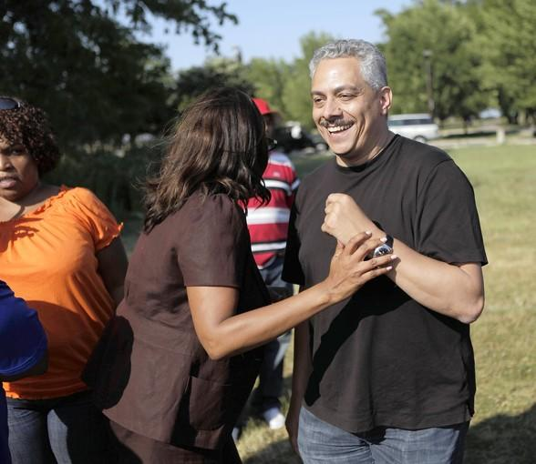 Chosen Few DJs member Alan King laughs with Ald. Leslie Hairston, 5th, while meeting with organizers and city officials last week to prepare for the Chosen Few Old School Reunion Picnic. It takes place Saturday.