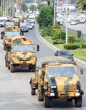 Turkish military vehicles head for the 500-mile border with Syria, where tension has continued to rise between the neighbors.