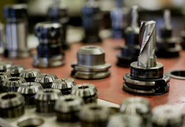 A variety of drill bits are used to create specialized metal fabricated parts for clients at the Memac Industries Inc. facility in Lancaster, Ohio. The manufacturing sector contracted for the first time since 2009.