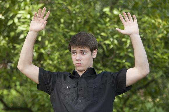Shane Botwin (Alexander Gould) puts his hands up.