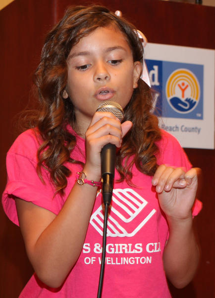 "Cassidy Rosa, 10, a member of the Boys & Girls Club of Wellington performed during the United Way of Palm Beach County's ""2011-2012 Annual Meeting & Campaign Awards Breakfast,"" which took place at the West Palm Beach Marriott."
