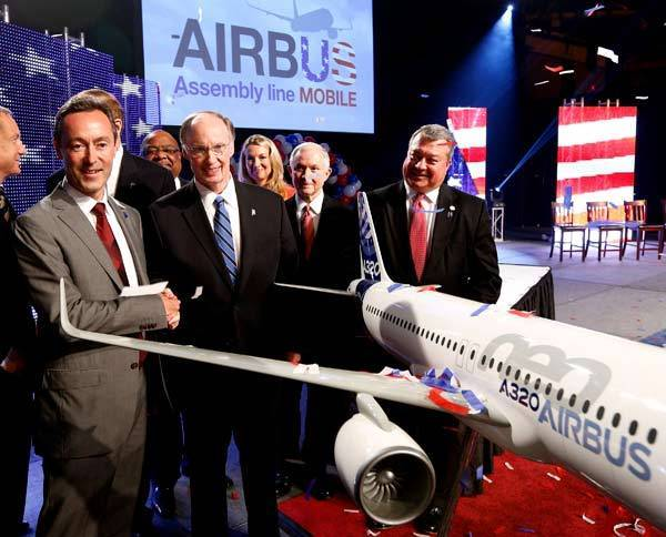 Airbus CEO Fabrice Bregier (L) shakes hands with Alabama Governor Robert Bentley during a news conference in Mobile, Ala. European planemaker Airbus held a news conference to announce that they will construct an assembly plant for their A320 in Mobile. The plant will give Airbus its first assembly site in the United States.