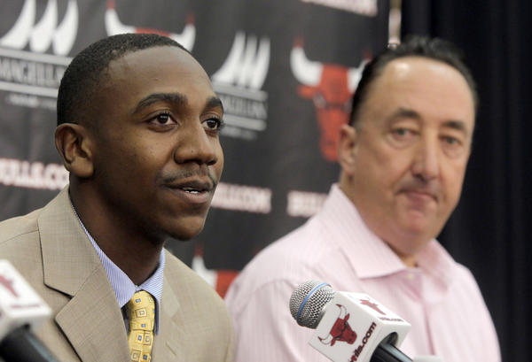 Bulls first round draft pick Marquis Teague speaks as Bulls General Manager Gar Forman looks on.