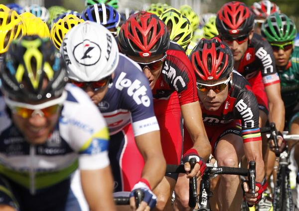 BMC Racing Team rider Cadel Evans of Australia (R) cycles during the second stage of the 99th Tour de France cycling race between Vise and Tournai, July 2, 2012.