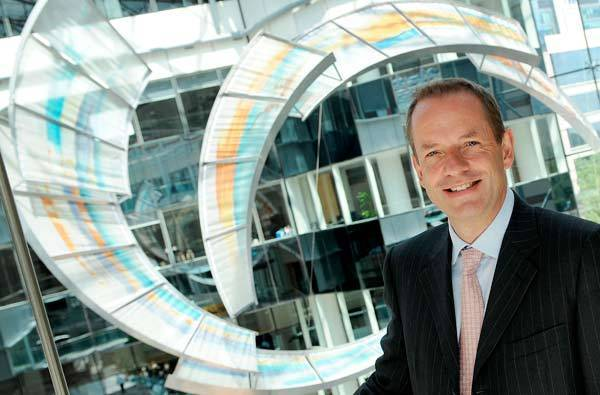 CEO of GlaxoSmithKline, Andrew Witty, poses for photographers outside the company headquarters in west London.
