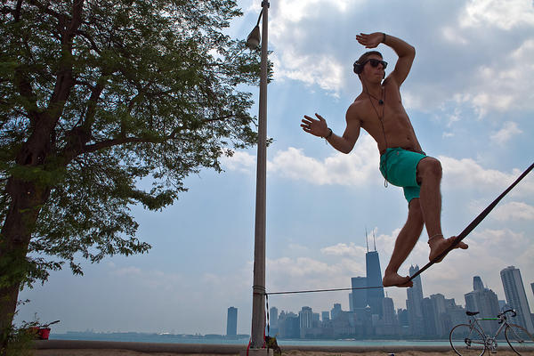 Frank Valenzano of Arlington Heights practices slacklining at North Avenue Beach in Chicago.