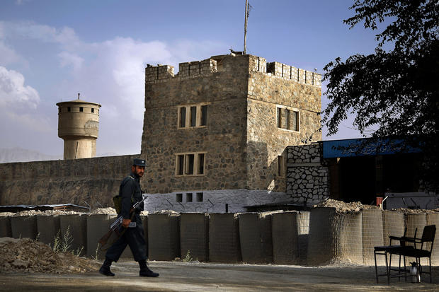 An Afghan prison guard keeps watch outside Pul-e-Charkhi Prison near Kabul. The site holds at least 1,200 prisoners, many of them former Taliban fighters. (Rick Loomis / Los Angeles Times)