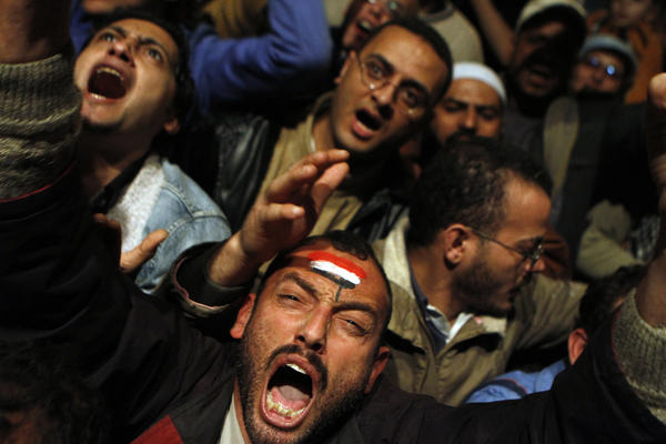 On Feb. 10, 2011, a day before Mubarak's resignation, Egyptian protesters react to a speech by him in which he said he wouldn't go.