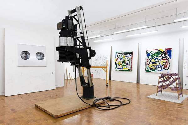 "An oversized enlarger used in photography dominates the center of the upstairs gallery in ""Amanda Ross-Ho: Teeny Tiny Woman."""