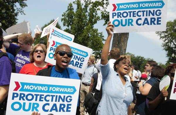 Supporters of Barack Obama's signature healthcare legislation celebrate after the US Supreme Court upheld the constitutionality of the Affordable Healthcare Act. Many employers are quietly considering a move away from traditional defined benefit plans and toward defined contribution plans, which set aside a fixed amount of money each year for employees to use toward health care costs.