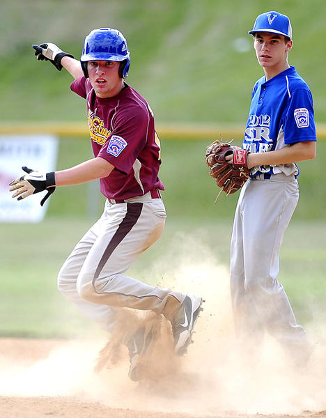Maugansville's Tyler Shindle, left, is safe at second base as Valley's Joseph Forti looks on during Monday's Maryland District 1 Senior championship game.
