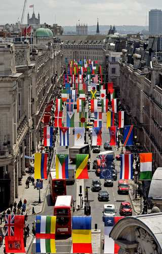 The national flags from countries participating in the London 2012 Olympic Games hang over Regent Street in central London.