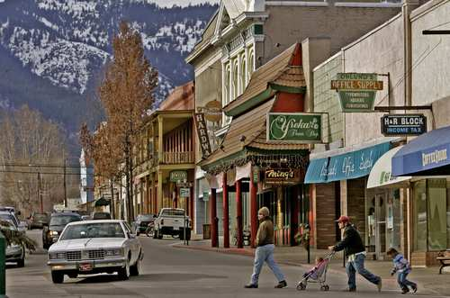 Pedestrians cross Miner Street in Yreka, a town of about 8,000 with Western-style architecture and turn-of-the-last-century homes.