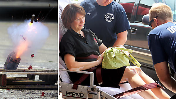 Laura Barros, assistant executive director of the Illinois Fire Safety Alliance, is taken to the hospital after her foot was burned during a fireworks safety demonstration in Mount Prospect. The fireworks exploded at an angle, left, instead of straight up.