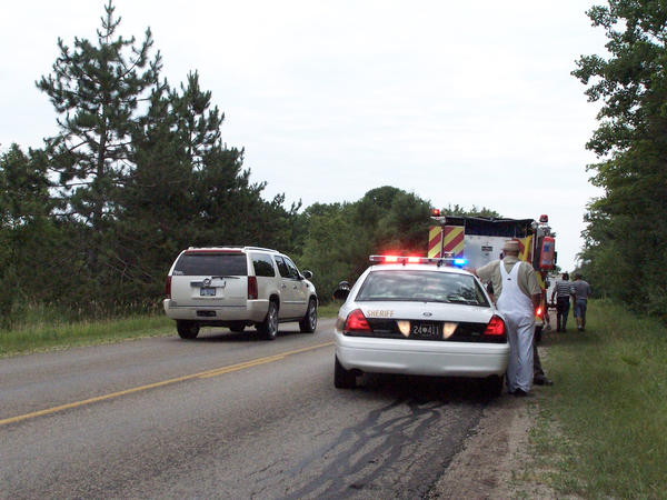 Officials at the scene of a collision involving a cyclist and a pick-up truck on Pickerel Lake Road on Tuesday, July 3.