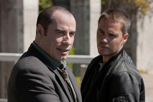 """John Travolta and Taylor Kitsch in """"Savages."""""""