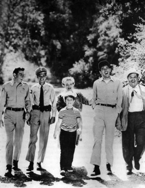 "Andy Griffith, left, as Sheriff Andy Taylor, and fellow citizens of stable, orderly Mayberry, where everyone has a smile, including Don Knotts (as Deputy Barney Fife), Francis Bavier (Aunt Bee), Ron Howard (Opie Taylor), Jim Nabors (Gomer Pyle) and Hal Smith (Otis Campbell). <style type=""text/css"">