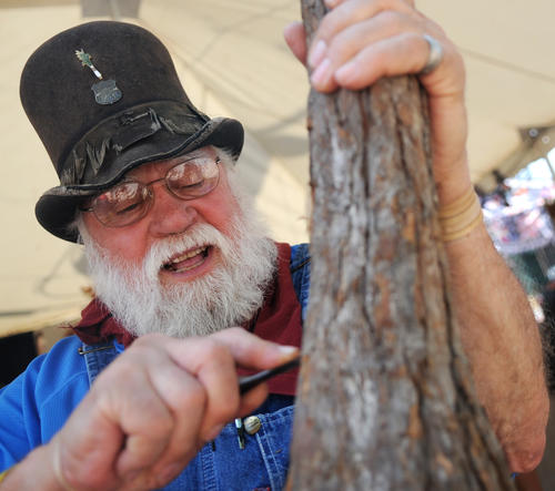 Self taught woodcarver Bob Evans, 79, of Pembroke, Virginia has been one of the crafters selling their wares for 30 years at the Kutztown Folk Festival. Evans specializes dwarf-like figures inspired from German folklore called Knobbits. Which he imagined and trademarked 30 years ago.