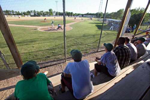 A group of teenagers watch the action at Thursday night's game between Groton and Northville at NorthWestern Energy Field. photo by john davis taken 6/28/2012