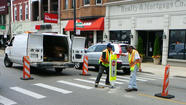 "City workers install a ""Stop for pedestrians within crosswalk"" signs. Chicago Department of Transportation photo"