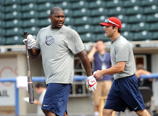 Philadelphia Phillies first basemen Ryan Howard collects baseballs along with IronPigs' Steve Susdorf during batting practice prior to his rehab start at Coca-Cola Park for the Lehigh Valley IronPigs Tuesday night against the Scranton / Wilkes-Barre Yankees.