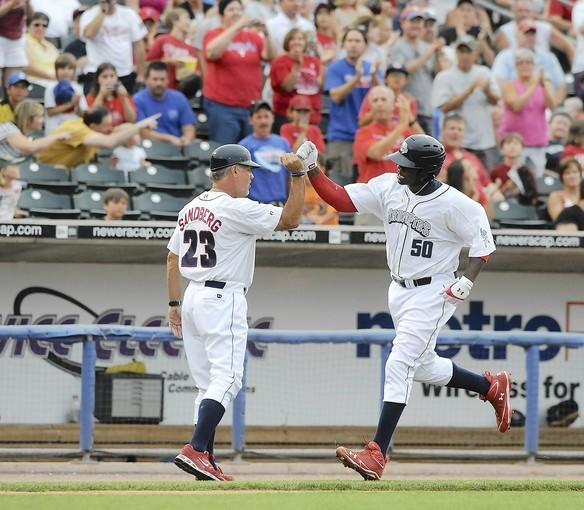 Lehigh Valley IronPigs' manager Ryne Sandberg (23) left, fist-bumps Ryan Howard (50) right, after he hit a two-run home run against the Scranton / Wilkes-Barre Yankees at Coca-Cola Park in Allentown Tuesday night.
