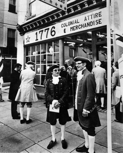 This photo looks like a scene from Colonial times, but was taken only 36 years ago at the opening of the Bicentennial Shoppe on West Franklin Street in downtown Hagerstown in November, 1975. The store was open through 1976, the year the nation celebrated its 200th birthday. Among the items for sale included full Colonial costumes for men, women and children, along with other bicentennial-themed clothing items, coins and souvenirs. The shop also served as the headquarters for Washington Countys observance of the bicentennial, highlighted by Rediscover America  A Bicentennial Remembrance, more than a week of special events centered around the Fourth of July. The events were sponsored by the Exchange Club of Hagerstown Foundation, in cooperation with the Washington County Bicentennial Committee. Pictured in the foreground in colonial garb are William Fielder and Robert P. Bohman. At left are Jesse L. Kagle and Luther Phillips.