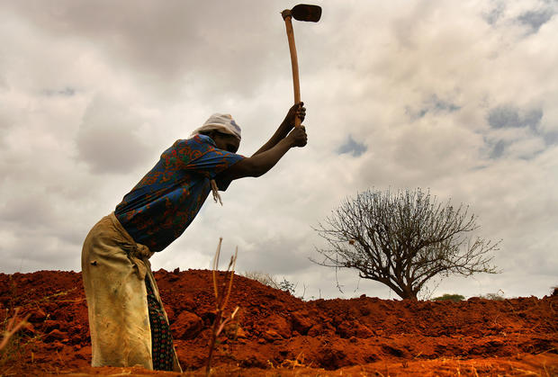 A farmer digs a trench in Kenya's Mwingi district, hoping to capture any rainwater that might come. As the world's population grows, researchers say, it will be increasingly difficult to produce enough food to feed everyone. (Rick Loomis / Los Angeles Times)