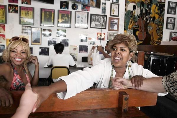 "Desiree Edwards greets customers at Watts Coffee House, which she has owned since 1994. ""I didn't take a single loan,"" she says. ""I ran on faith and prayer."""