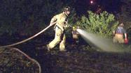 Firefighters stop grass fire just short of houses