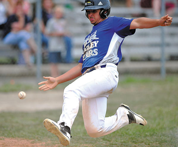 Valley's Alex Myers tries to beat the ball to home plate with a slide, scoring against Maugansville on Tuesday in the losers' bracket final of the Maryland District 1 Junior tournament. Maugansville won, 15-12.